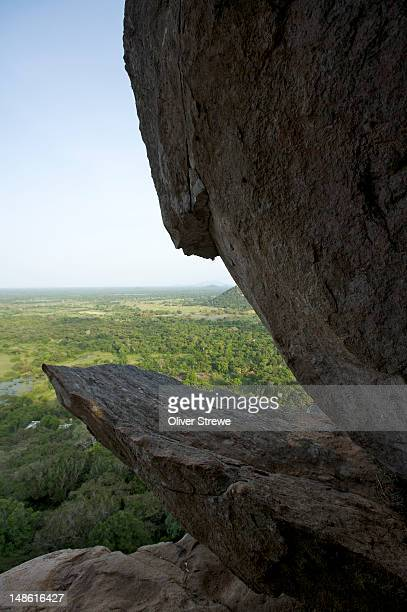 granite boulders of mihintale hills with landscape below. - mihintale stock pictures, royalty-free photos & images