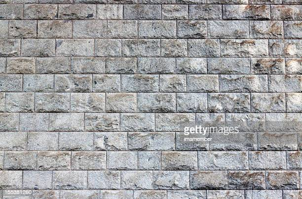 Granite bricks wall background with copy space