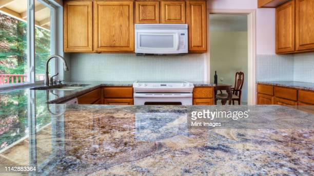 granite counter reflecting kitchen cabinets - granite rock stock pictures, royalty-free photos & images