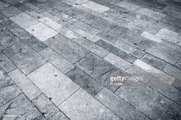 granite square texture background with dark edges - adoquinado fotografías e imágenes de stock