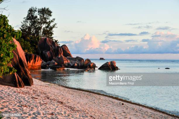 granitic rocks on the beach of anse source d'argent in a sunset time. la digue island. seychelles - idyllic stock pictures, royalty-free photos & images