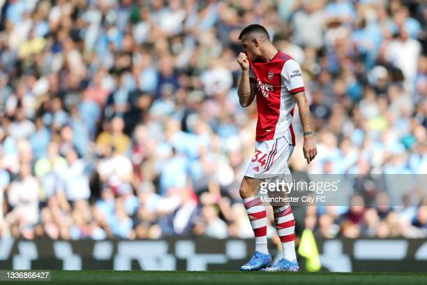 GranitXhaka of Arsenal makes their way off after being shown a red card during the Premier League match between Manchester City and Arsenal at...