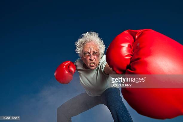 granny boxing - funny boxing stock photos and pictures