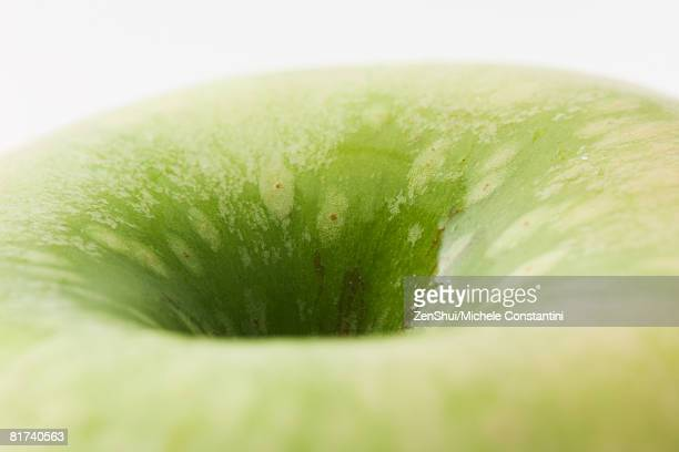 Granny Smith apple, extreme close-up, cropped view