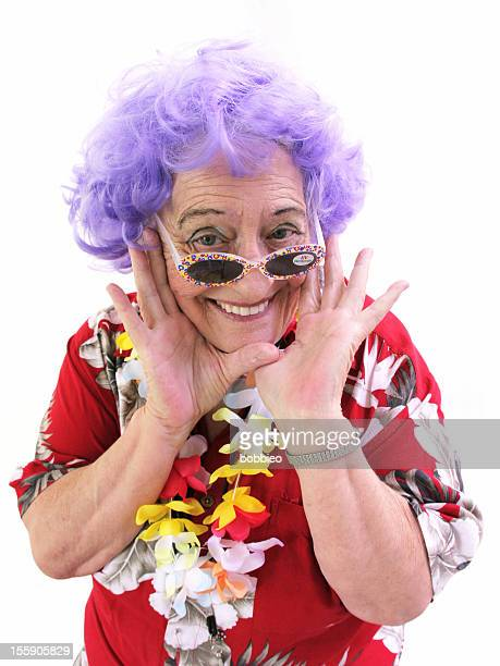granny whack series: tourist with sunglasses smiling - purple hair stock photos and pictures