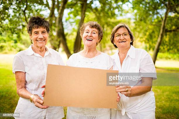 grannys with blank sign - blank sign stock photos and pictures