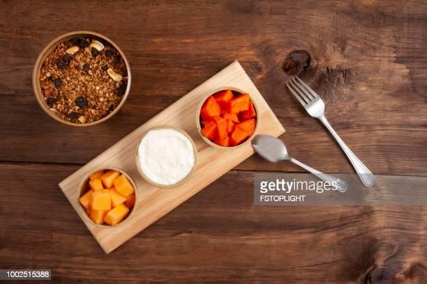 Granola and tropical fruits
