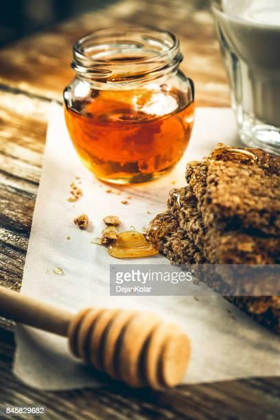 Granola bars, milk and honey