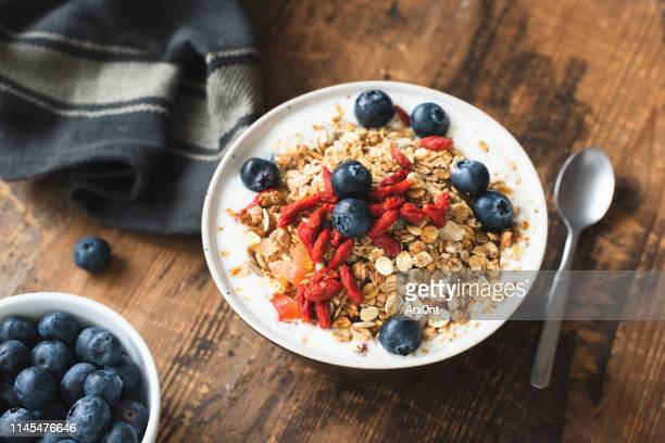 granola bowl with yogurt, berries - nut food stock pictures, royalty-free photos & images
