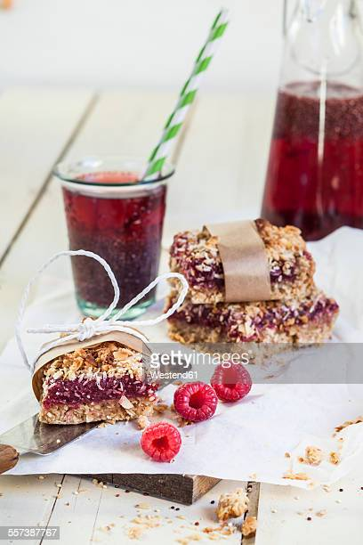 Granola breakfast bar with red fruit filling and iced Hibiscus infusion with Chia