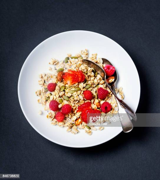 granola with berries - rolled oats stock photos and pictures