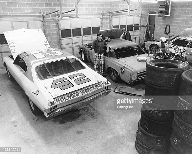 Grant Adcox with several of his cars inside his shop in Chattanooga TN Adcox moved from a successful short track career to NASCAR in the 1970s and...