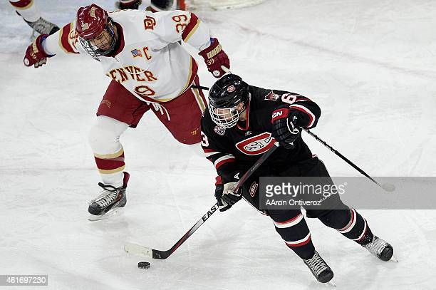 Grant Arnold of the Denver defends Patrick Russell of the St Cloud St during the second period of action The University of Denver hosted St Cloud...