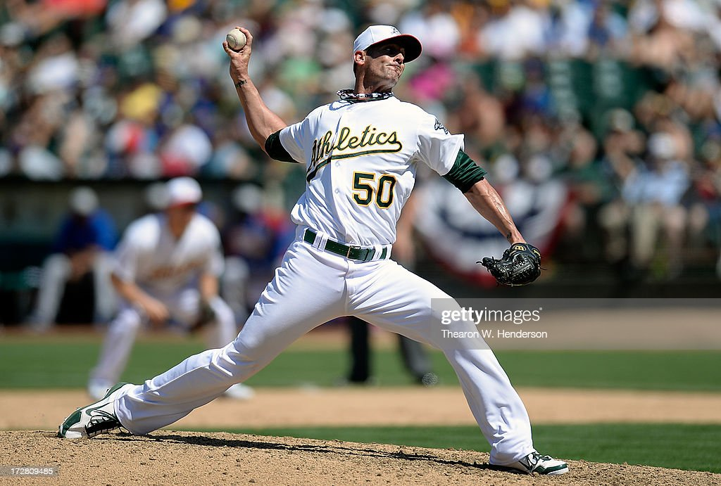 Grant Balfour #50 of the Oakland Athletics pitches in the ninth inning against the Chicago Cubs at O.co Coliseum on July 4, 2013 in Oakland, California. The Athletics defeated the Cubs 1-0.