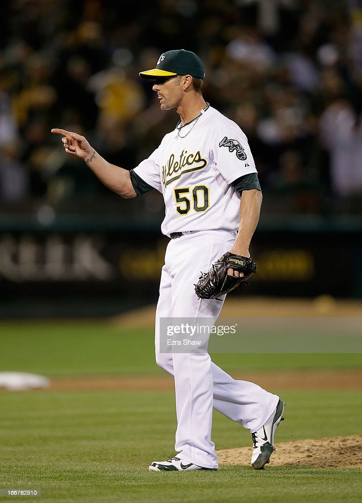 Grant Balfour #50 of the Oakland Athletics reacts after the Oakland Athletics beat the Houston Astros 4-3 at O.co Coliseum on April 16, 2013 in Oakland, California.