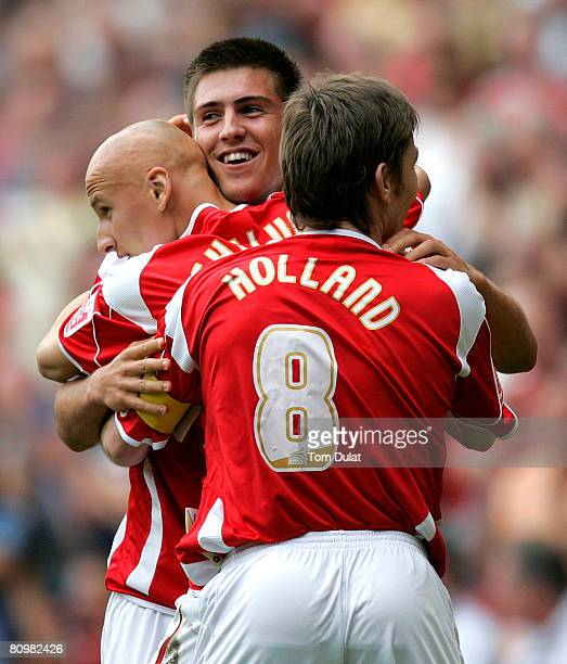 Grant Basey of Charlton Athletic celebrates scoring his side's third goal together with Jonjo Shelvey and Matt Holland during the Coca Cola...