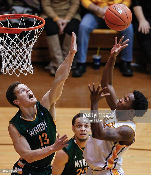 Grant Benzinger of the Wright State Raiders guards the shot of Keith Carter of the Valparaiso Crusaders at AthleticsRecreation Center on February 21...