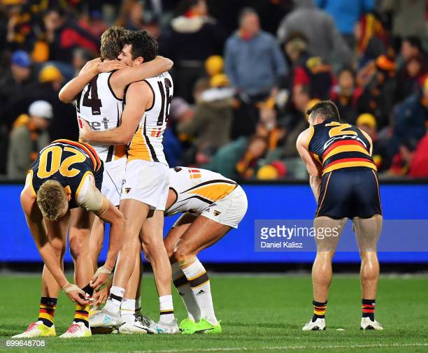 Grant Birchall and Isaac Smith of the Hawks celebratre after the final siren during the round 14 AFL match between the Adelaide Crows and the...