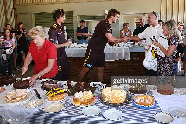 Grant Birchall choses the winner of the cake baking competition at the Bream Creek Oval during the Hawthorn Hawks AFL Tasmania Community Camp on...