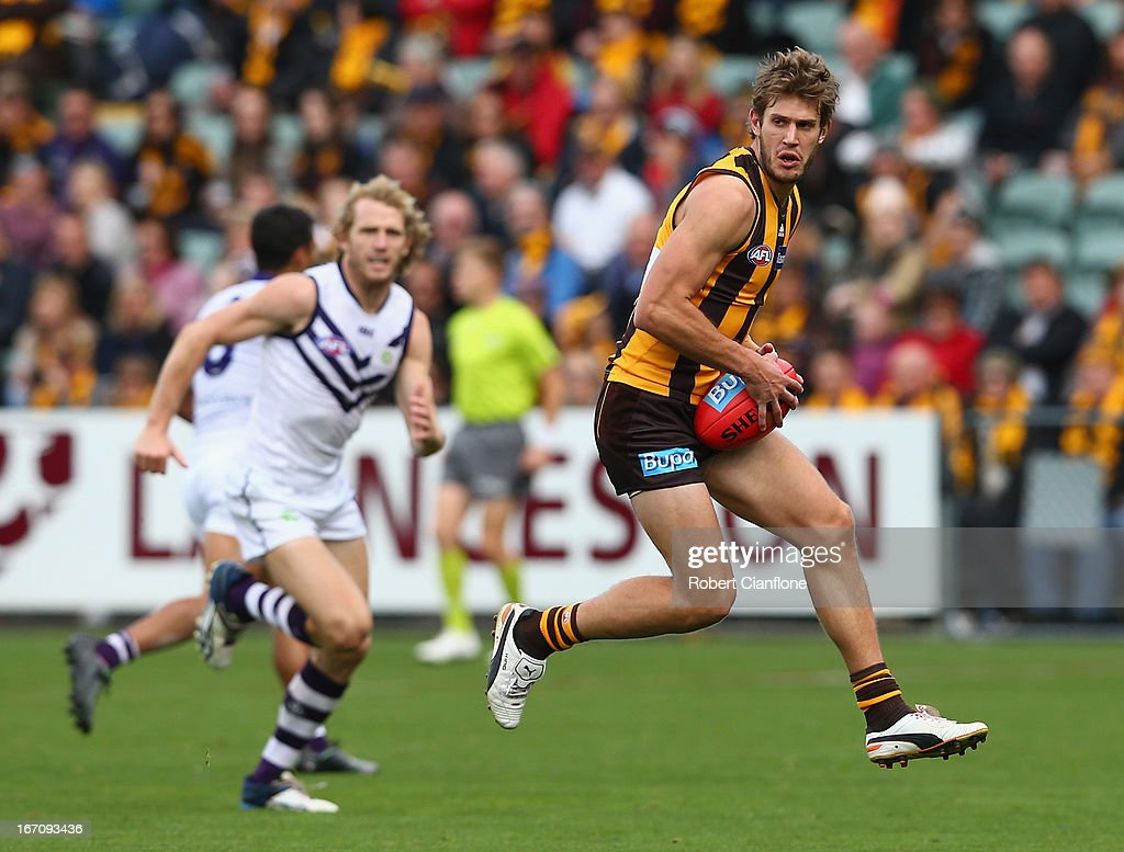Grant Birchall of the Hawks controls the ball during the round four AFL match between the Hawthorn Hawks and the Fremantle Dockers at Aurora Stadium on April 20, 2013 in Launceston, Australia.