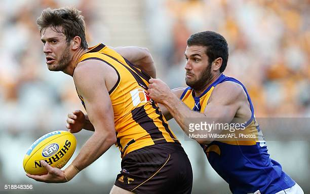 Grant Birchall of the Hawks is tackled by Jack Darling of the Eagles during the 2016 AFL Round 02 match between the Hawthorn Hawks and the West Coast...