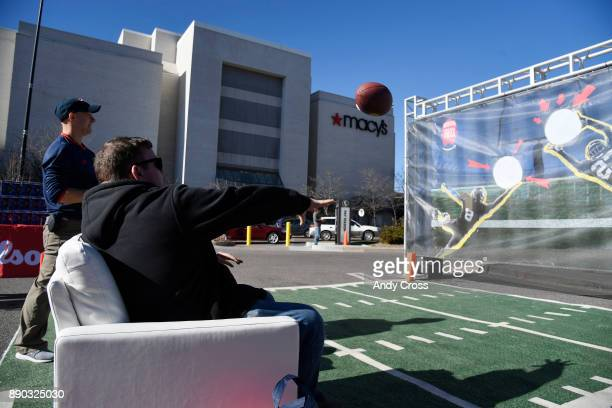 Grant Boeringa tries his armchair quarterback skills at the Amazon's Treasure Truck parked at the Cherry Creek Mall Saturday December 09 2017 The...