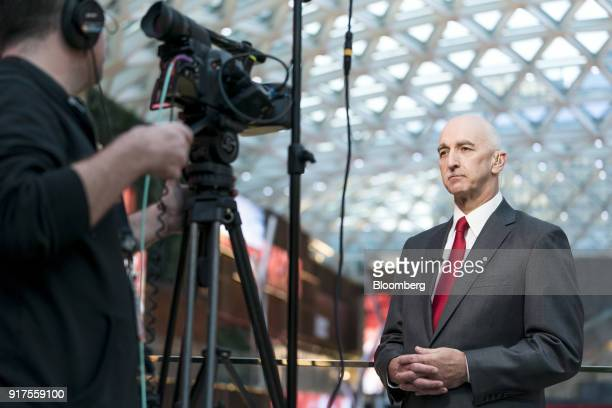 Grant Bowie chief executive officer of MGM China Holdings Ltd listens during a Bloomberg Television interview in Macau China on Tuesday Feb 13 2018...