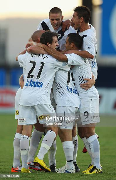 Grant Brebner of the Victory celebrates with his team after scoring a goal during the round 21 ALeague match between the Central Coast Mariners and...