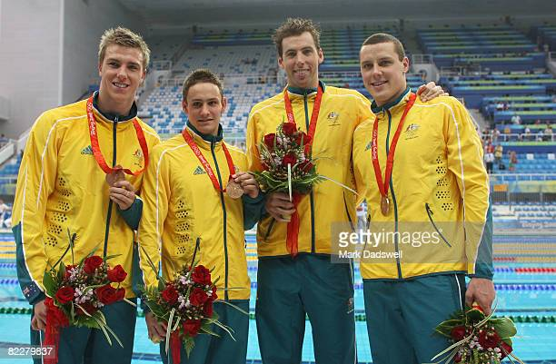 Grant Brits Nick Ffrost Grant Hackett Patrick Murphy of Australia pose with the bronze medal during the medal ceremony for the Men's 4 x 200m...