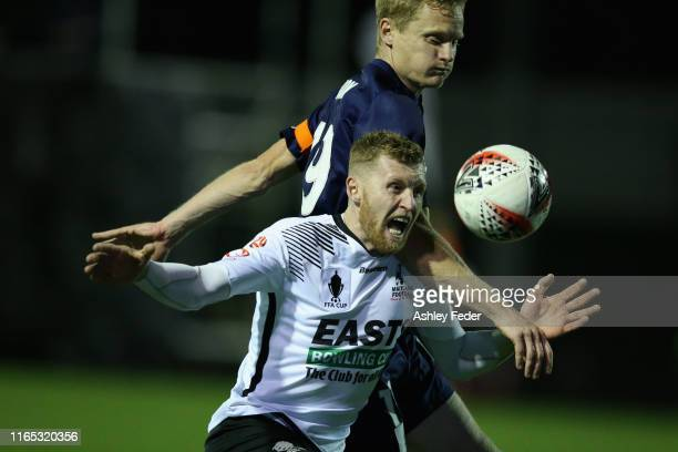 Grant Brown of Maitland FC is contested by Matt Simon of the Central Coast Mariners during the FFA Cup Round of 32 match between Maitland FC and...