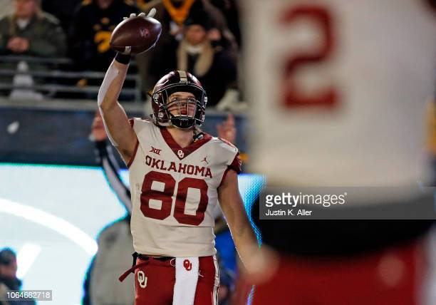 Grant Calcaterra of the Oklahoma Sooners celebrates after catching a 2 yard touchdown pass in the second half against the West Virginia Mountaineers...