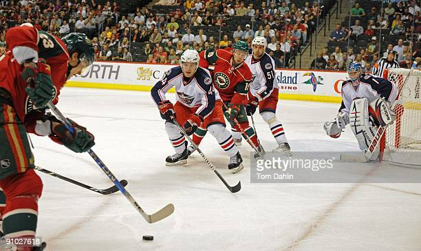 Grant Clitsome Fedor Tyutin and Steve Mason of the Columbus Blue Jackets defend against Andy Hilbert of the Minnesota Wild during the first period of...