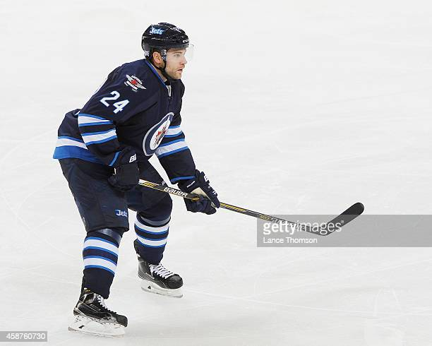 Grant Clitsome of the Winnipeg Jets keeps an eye on the play during second period action against the Nashville Predators on November 4 2014 at the...