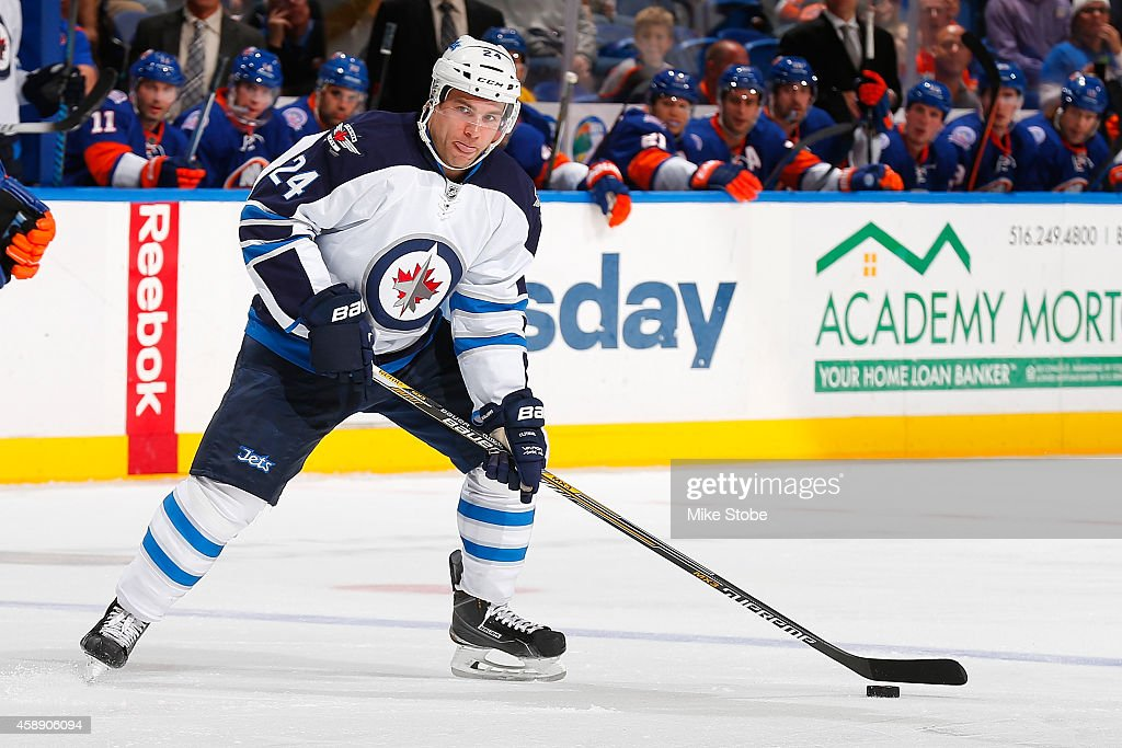 Grant Clitsome #24 of the Winnipeg Jets skates against the New York Islanders at Nassau Veterans Memorial Coliseum on October 28, 2014 in Uniondale, New York. The Winnipeg Jets defeated the New York Islanders 4-3.