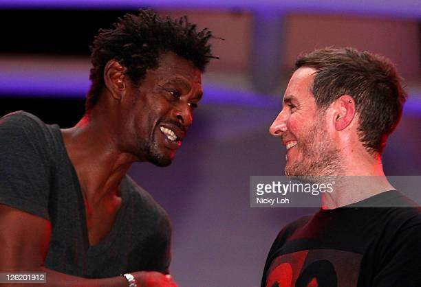 Grant 'Daddy G' Marshall and Robert '3D' Del Naja of Massive Attack perform on stage during the Singapore Formula One Grand Prix at the Esplanade on...