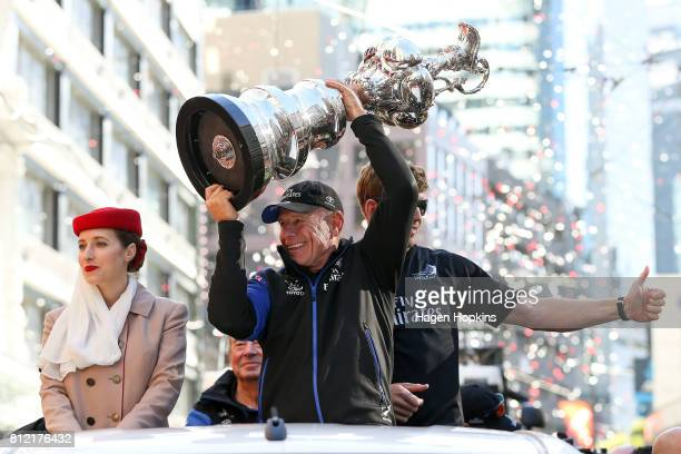 CEO Grant Dalton holds the Americas Cup while Helmsman Peter Burling looks on during the Team New Zealand Americas Cup Wellington Welcome Home Parade...