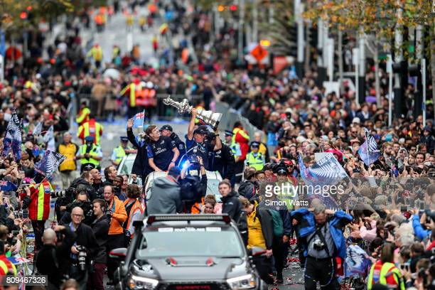 Grant Dalton of Team New Zealand holds the Americas Cup as Peter Burling celebrates during the Team New Zealand Americas Cup Welcome Home Parade on...