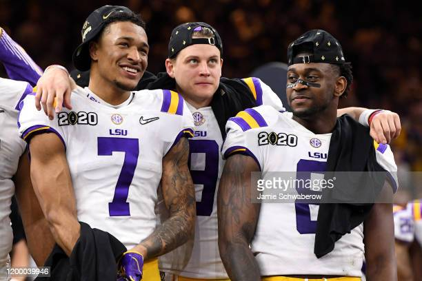 Grant Delpit Joe Burrow and Patrick Queen of the LSU Tigers celebrate after defeating the Clemson Tigers during the College Football Playoff National...