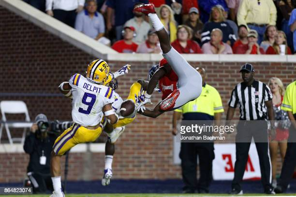 Grant Delpit of the LSU Tigers and Donte Jackson break up a pass intended for AJ Brown of the Mississippi Rebels during the second half of a game at...