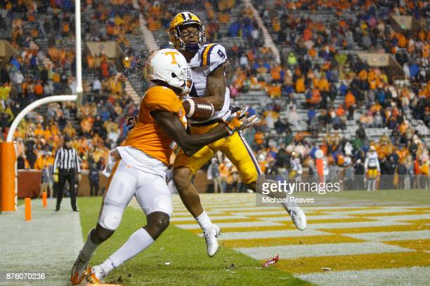 Grant Delpit of the LSU Tigers breaks up a pass intended for Brandon Johnson of the Tennessee Volunteers during the second half at Neyland Stadium on...