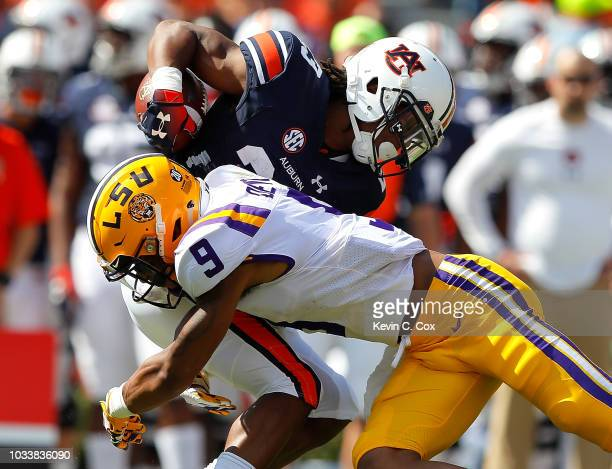 Grant Delpit of the LSU Tigers breaks up a reception intended for Ryan Davis of the Auburn Tigers at JordanHare Stadium on September 15 2018 in...