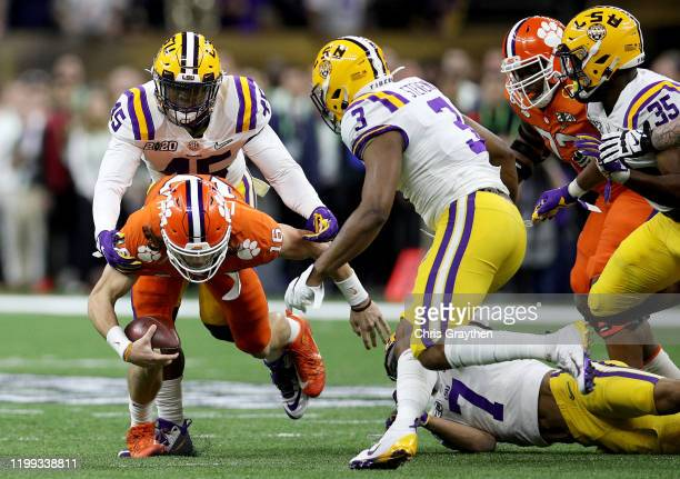 Grant Delpit of the LSU Tigers sacks Trevor Lawrence of the Clemson Tigers during the first quarter in the College Football Playoff National...
