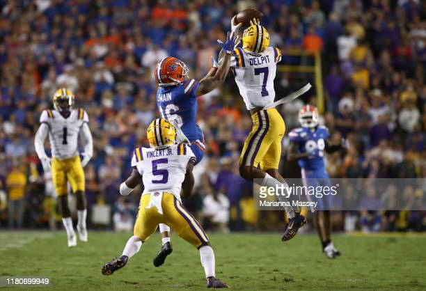 Grant Delpit of the LSU Tigers tries for an interception against Freddie Swain of the Florida Gators at Tiger Stadium on October 12 2019 in Baton...