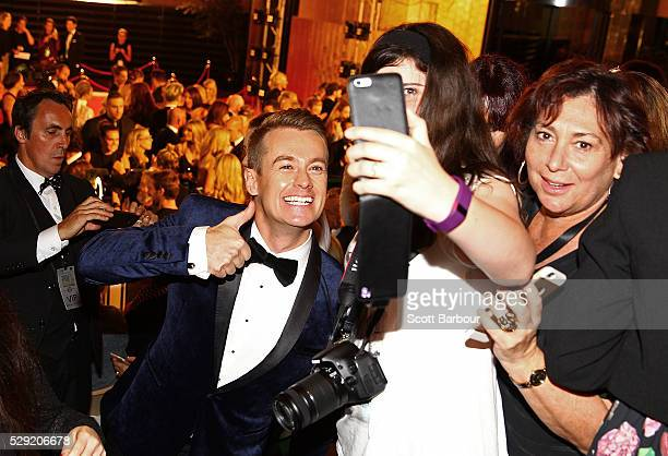 Grant Denyer poses for selfies with supporters in the crowd as he arrives at the 58th Annual Logie Awards at Crown Palladium on May 8 2016 in...