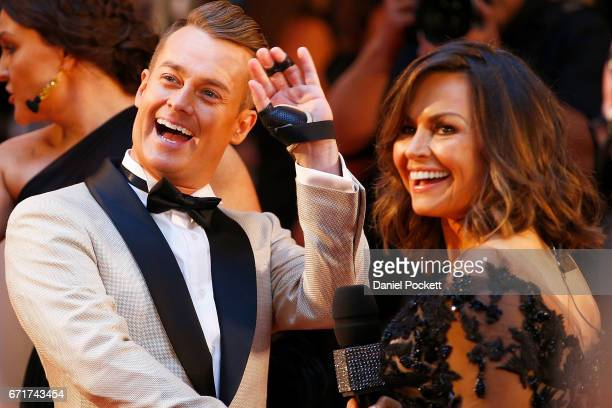 Grant Denyer waves to fans whilst talking to Lisa Wilkinson arrives at the 59th Annual Logie Awards at Crown Palladium on April 23 2017 in Melbourne...