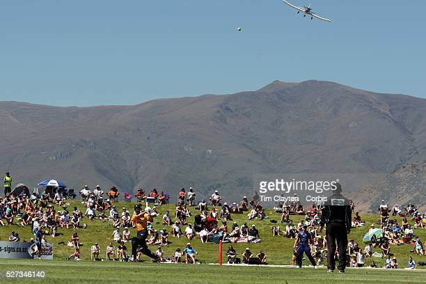 Grant Elliot Wellington hits a six as a light aircraft prepares to land at Queentown airport during the Otago Voltz V Wellington Firebirds HRV Cup...
