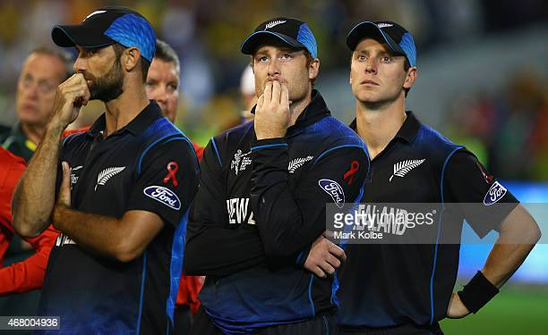 Grant Elliott, Martin Guptill and Matt Henry of New Zealand look dejected after defeat during the 2015 ICC Cricket World Cup final match between...