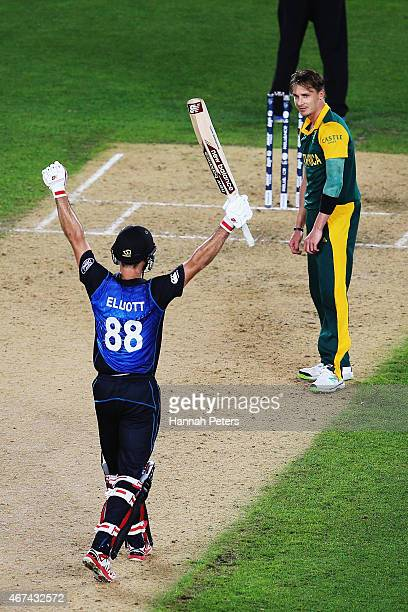 Grant Elliott of New Zealand celebrates after hitting the winning runs as Dale Steyn of South Africa looks on during the 2015 Cricket World Cup Semi...