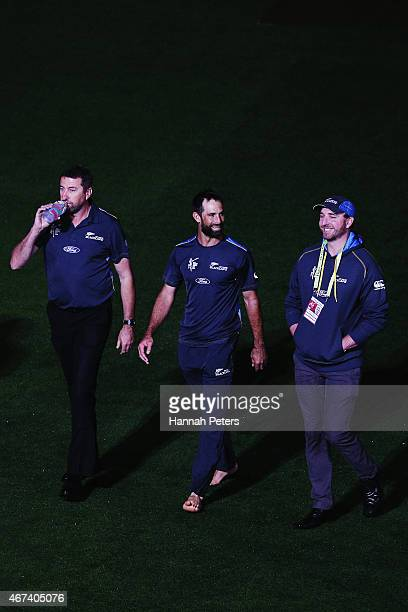 Grant Elliott of New Zealand walks across the field to the post match press conference after winning the 2015 Cricket World Cup Semi Final match...
