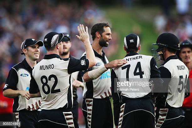 Grant Elliott of the Black Caps celebrates the wicket of Sohaib Maqsood of Pakistan during the International Twenty20 match between New Zealand and...